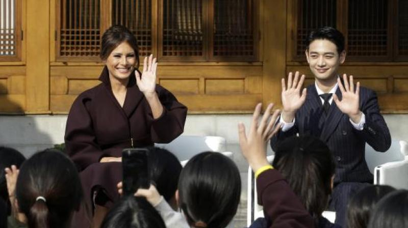 The video showed Trump at ease with South Korean teenagers in school uniforms at an event where the first lady gave a speech. (Photo: AP)