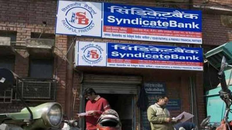 Shares of Syndicate Bank on Tuesday tumbled over 12 per cent after the company reported a net loss of Rs 2,195.12 crore in the quarter ended March 2018.