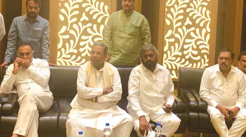 Congress leaders Dinesh Gundurao (seated, from L),  Siddaramaiah, Eshwar Khandre and G. Parameshwar at CLP meeting in Bengaluru on Sunday (Photo: DC)