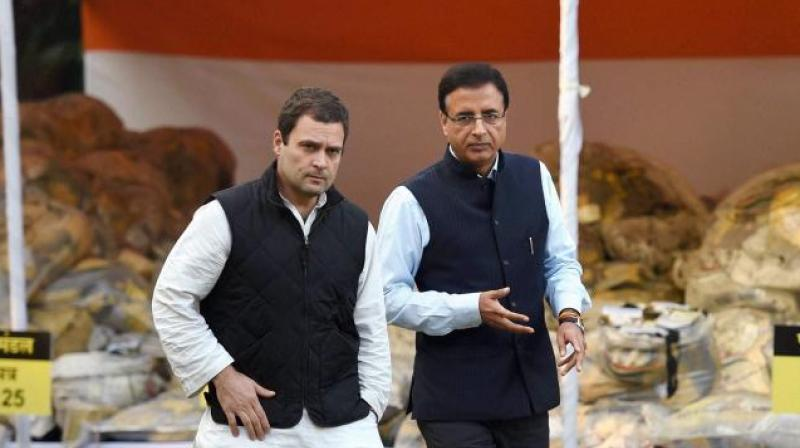 Criminal defamation suits were filed before a local court on Monday against Congresss leaders Rahul Gandhi and Randeep Singh Surjewala by the Ahmedabad District Cooperative Bank. (Photo: PTI)