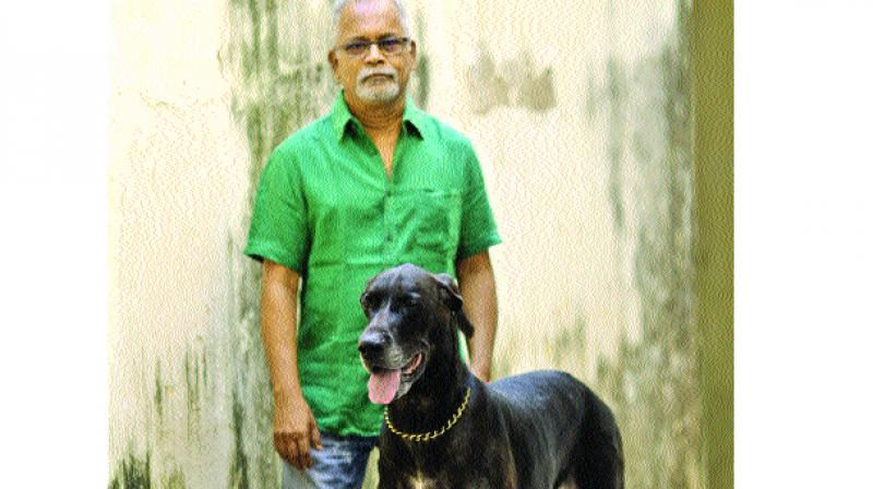 Charu Nivedita with his pet.