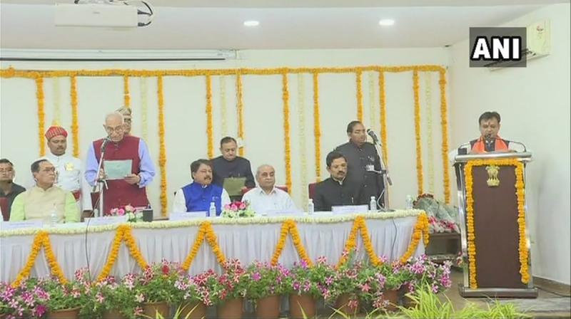 The function was held in the presence of select few including the chief minister, few ministers and some top officials inside the Raj Bhavan without any prior announcement. (Photo: Twitter/ANI)
