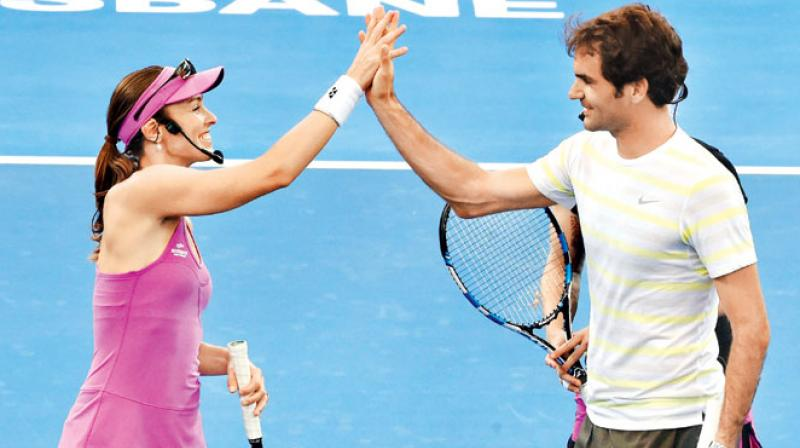 Federer said that  Martina was partially the one who showed him how it was all done. (Photo:AP)