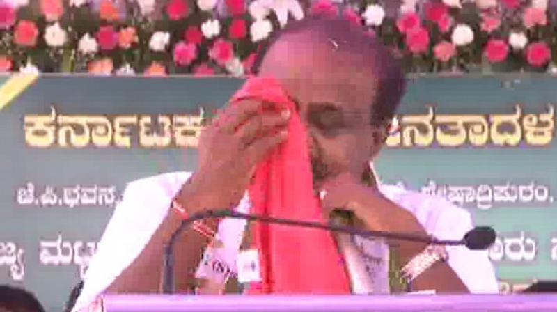 Throughout his address, HD Kumaraswamy was teary-eyed and repeatedly kept wiping his tears away with a handkerchief. (Photo: ANI)