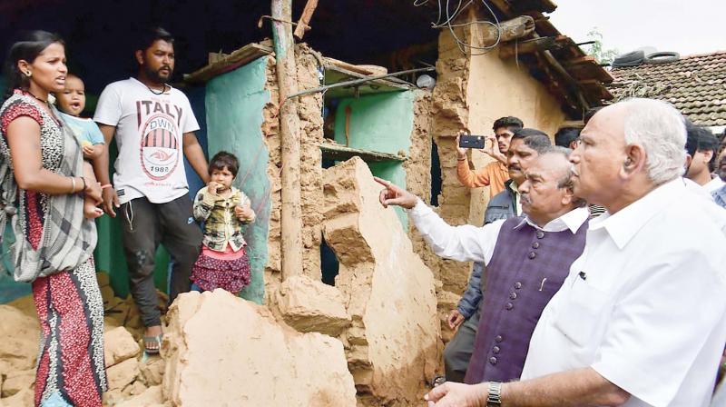 Chief Minister B.S. Yediyurappa visits a flood-hit area in Shivamogga district on Tuesday.