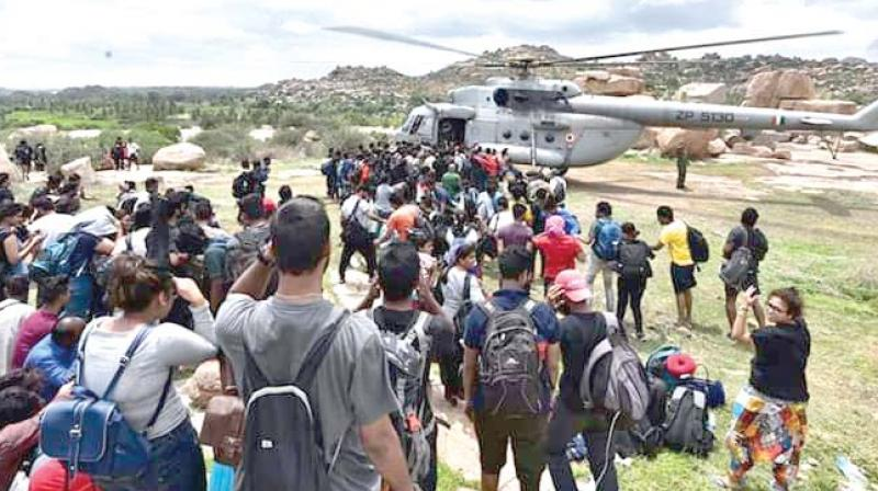 Tourists being airlifted from Virupapura Gadde, popularly known as 'Hippie Island' in the Tungabhadra river in Gangavati taluk of Koppal district close to Hampi.