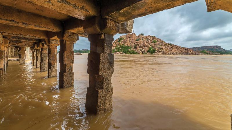 A flooded temple complex in Hampi on Tuesday (Photo:  PTI)