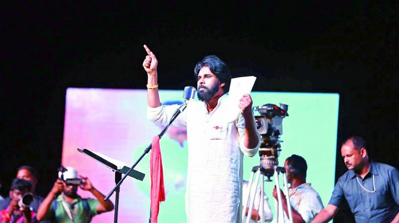 Jana Sena Chief Pawan Kalyan addresses his followers on the occasion of the party's 5th formation day at the Arts College in Rajahmundry on Thursday.