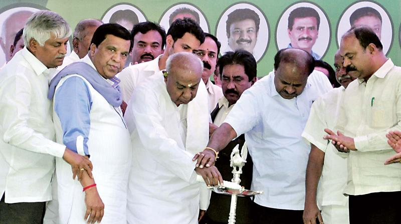 JD(S) supremo H.D. Deve Gowda and CM H.D. Kumaraswamy inaugurate a party rally in Mandya on Thursday.