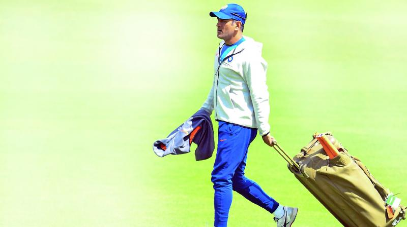 M.S. Dhoni arrives for a training session at  the Oval on Saturday. (Photo: AFP)