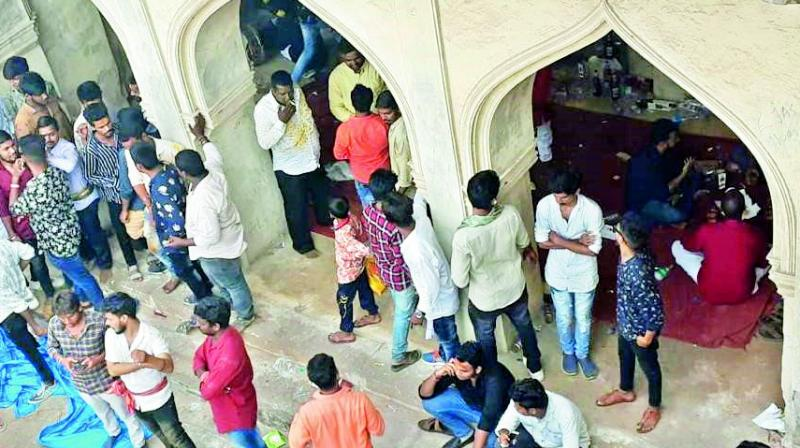 People gather at an unused mosque in Golconda Fort on Tuesday after reports on social media suggested some people were sitting there with liquor bottles. (Photo: DC)