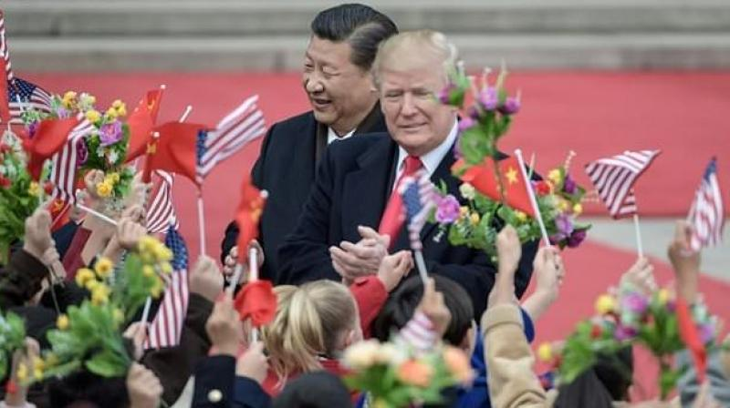Xi hosted Trump at the imposing Great Hall of the People, next to Tiananmen Square, for the main event of Trump's five-nation tour of Asia. (Photo: AFP)