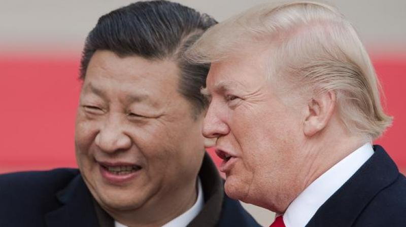 China's President Xi Jinping and his US counterpart Donald Trump attend a welcome ceremony in Beijing on 9 November. (Photo: AFP)