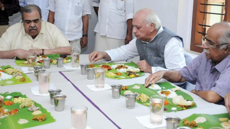 Governor Arif Muhammed Khan having lunch with his longtime friend former union minister K.P. Unnikrishnan at the latter's home at Panniyankara in Kozhikode on Saturday. (Photo: DC)