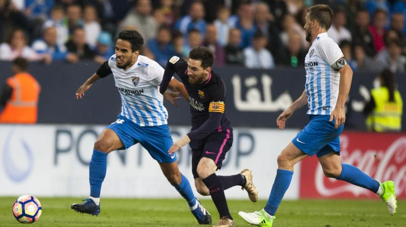 Malaga finally picked off the 10 men in the final minute when Pablo Fornals unselfishly squared for Jony to smash home from close range. (Photo: AP)