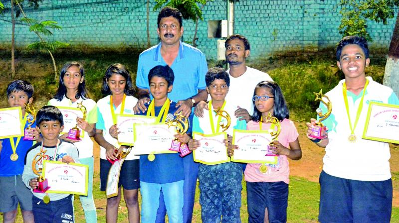 Winners of the tennis tournament at the Sarojini Cricket, Tennis and Fitness Academy pose with SCFA secretary G. Kiran Reddy in Hyderabad.