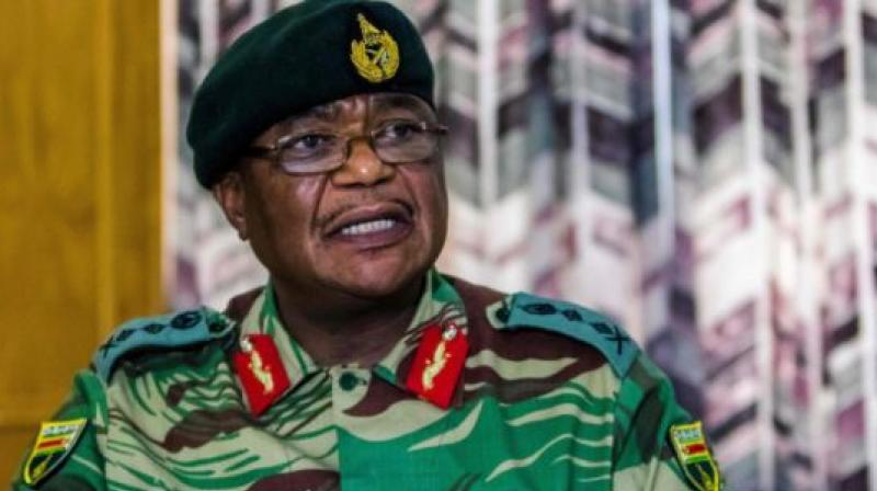 Zimbabwe Army General Constantino Chiwenga Commander of the Zimbabwe Defence Forces addresses a media conference held at the Zimbabwean Army Headquarters on November 13, 2017 in Harare. (Photo: AFP)