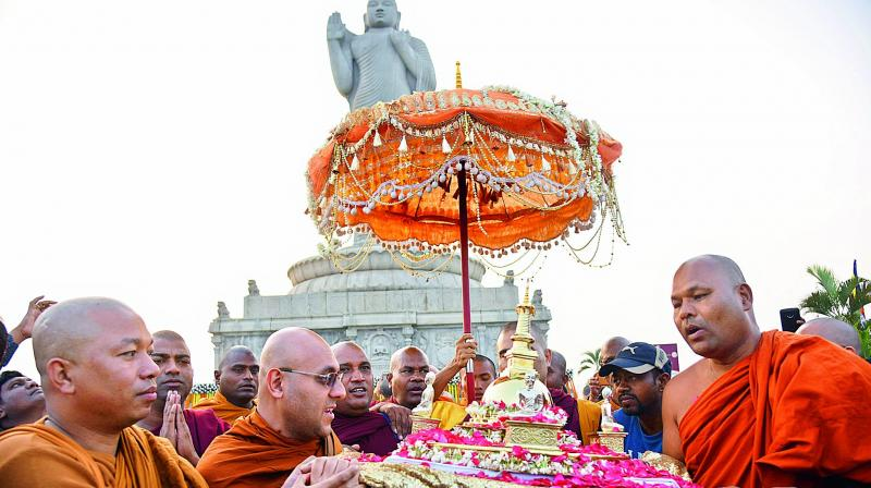 Monks carry the Holy relics of Lord Buddha during a procession at the Hussainsagar lake.  (Gandhi)