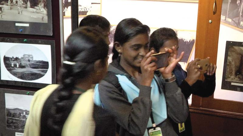 Young girls taking snaps of the display at the  exhibition venue. (DC)