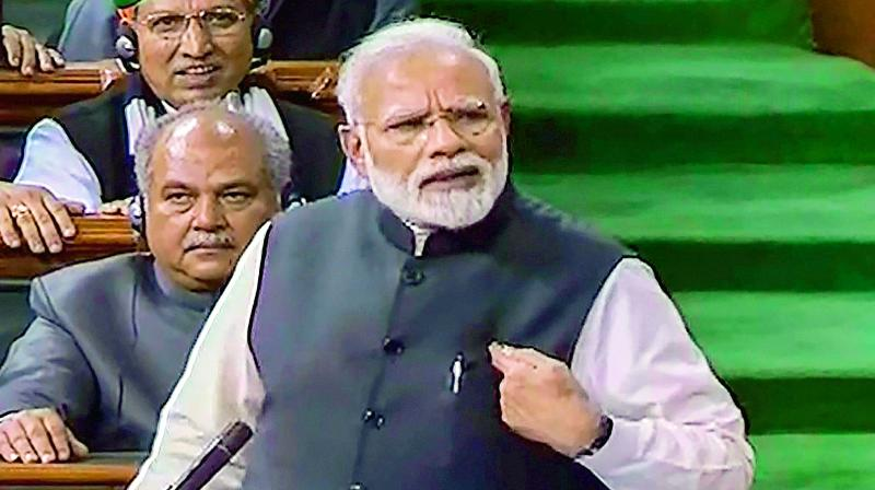 Prime Minister Narendra Modi addresses the Lok Sabha during the Budget Session of Parliament on Thursday.   (PTI)