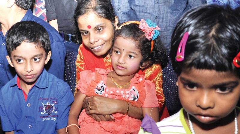 Visually challenged playback singer Vaikom Vijayalakshmi along with cochlear implanted children at a union organised in Kochi.  (DC  file photo)