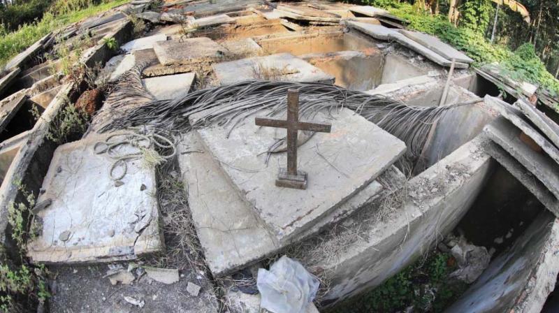 The vacant tombs at the cemetery of Little Flower Church, Pushpagiri, near Koodaranji in Kozhikode.