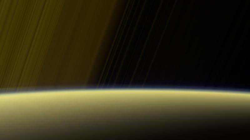 This false-color view from NASA's Cassini spacecraft gazes toward the rings beyond Saturn's sunlit horizon, where a thin haze can be seen along the limb. (Image credit: NASA/JPL-Caltech/Space Science Institute)