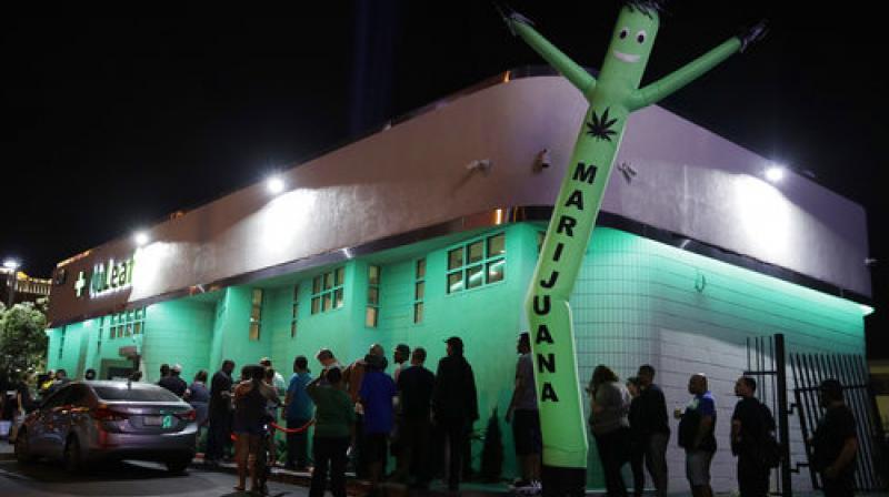 In this Saturday, July 1, 2017, photo, people line up at the NuLeaf marijuana dispensary in Las Vegas.(Photo: AP)