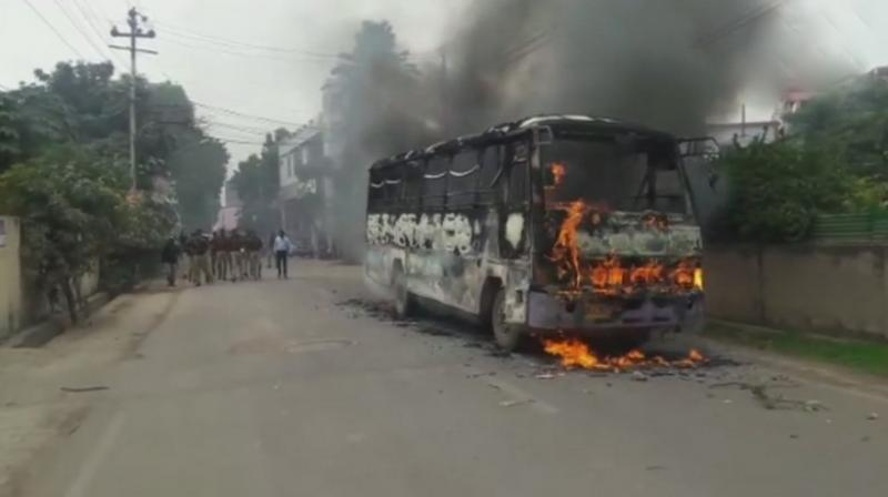 Students at Allahabad in Uttar Pradesh shouted slogans on the streets, hurled stones and set fire to a bus on Monday over the killing of 26-year-old law student at a restaurant by a group of men on Friday. (Photo: ANI | Twitter)