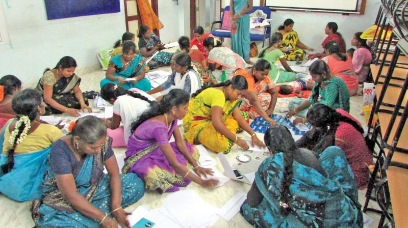 Women taking training in producing paper and jute bags at RSETI of IOB at Thanjavur.	– DC