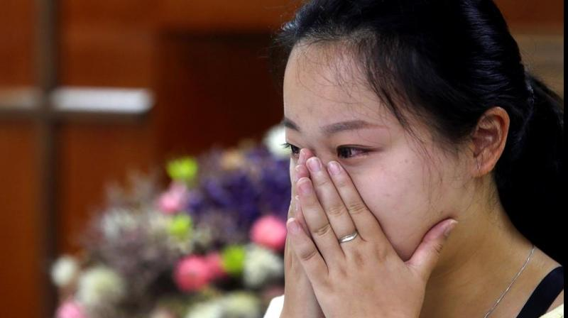 Liao Qiang worships publicly for the first time. (Photo: AP)