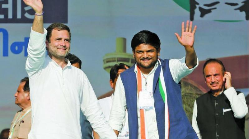 Patidar leader Hardik Patel with Congress president Rahul Gandhi as he joins Congress during a public meeting in Gandhinagar on Tuesday. (Photo: PTI)
