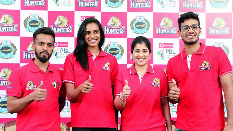 Ace shuttler P. V. Sindhu (second from left) poses with her teammates from the Hyderabad Hunters Arun George (left), Meghana Jakkampudi (second from right) and Rahul Yadav (right) during a press conference in Hyderabad on Monday.