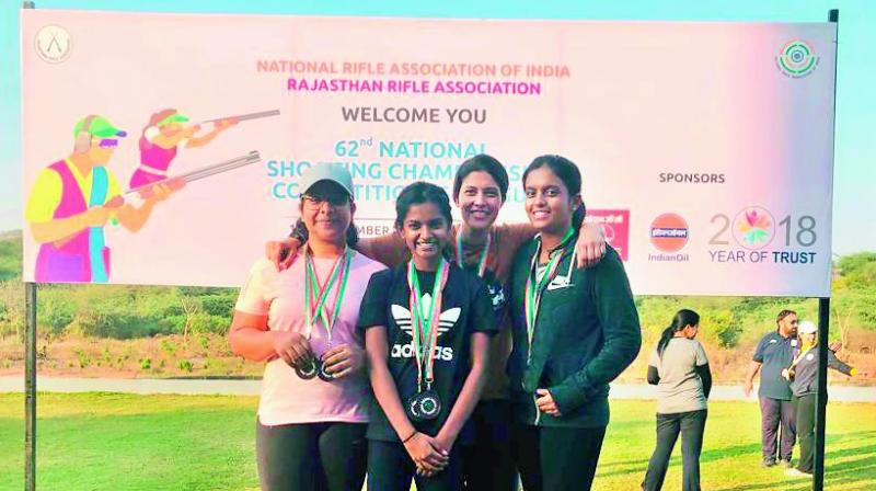 Telangana shooters Zahra Mufaddal Deesawala, Rashmmi Rathore, Dandu Katyayani Raju and Sonali Raju Nalaparaju pose after winning bronze medals in the women's senior and junior team events in clay pigeon skeet category at National Shooting in Jaipur.