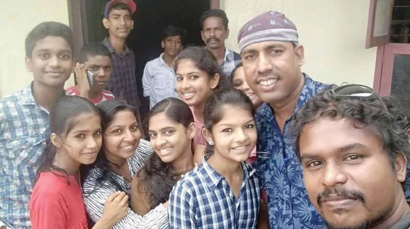 Rafeeq Mangalasserry (blue shirt) and the crew of Kithab drama