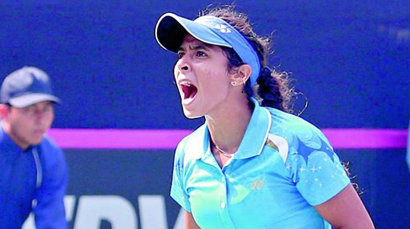 Ankita Raina celebrates her win over Chinese Taipei's Chieh-Yu Hsu in the Fed Cup on Saturday.