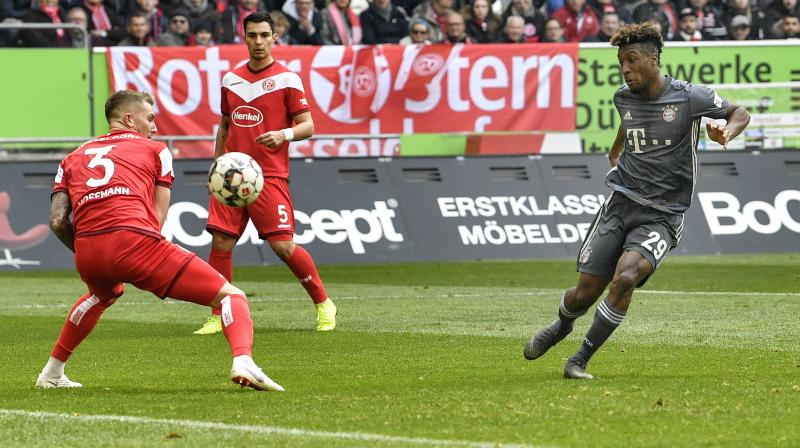 Champions Bayern Munich eased past hosts Fortuna Duesseldorf 4-1 on Sunday with winger Kingsley Coman scoring twice, to go a point clear at the top of the Bundesliga.  (Photo: AP)