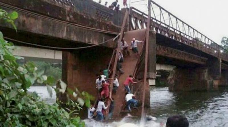 Around 50 people had gathered on the bridge to watch the rescue efforts when it gave way and they plunged into the water. (Photo: PTI)
