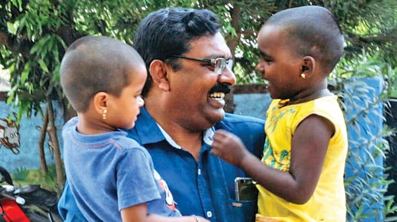 Solomon Raj with his kids from Shelter Trust.