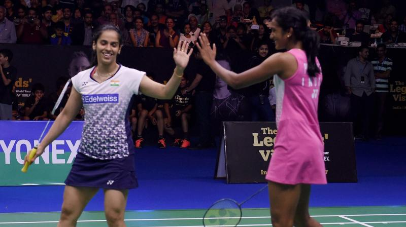 Saina Nehwal and PV Sindhu joined hands to beat Lin Dan and Lee Chong Wei 5-4 in a doubles exhibition game. (Photo: PTI)