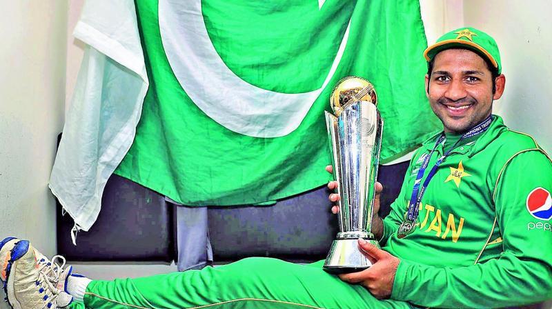 Pakistan captain Sarfraz Ahmed poses with the trophy.