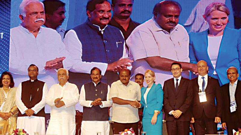 (From left) State Ministers Priyank Kharge, R.V. Deshpande, K.J. George, Chief Minister H.D. Kumaraswamy, Kate Jones Minister for Innovation, Tourism Industry Development, Queensland, Australia, and others during the  inauguration of 'Bengaluru Tech Summit 2018' at Bengaluru Palace on Thursday 	—KPN