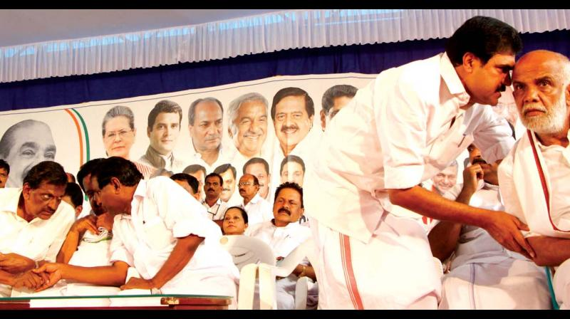 As KCM working chairman P.J. Joseph, opposition leader Ramesh Chennithala and Thiruvanchoor Radhakrishnan, MLA, were discussing a point on one side of the stage at the UDF convention in Pala on Thursday, Jose K. Mani, MP, was seen whispering in the ear of candidate Jose Tom. (DAs KCM working chairman P.J. Joseph, opposition leader Ramesh Chennithala and Thiruvanchoor Radhakrishnan, MLA, were discussing a point on one side of the stage at the UDF convention in Pala on Thursday, Jose K. Mani, MP, was seen whispering in the ear of candidate Jose Tom. (DC)