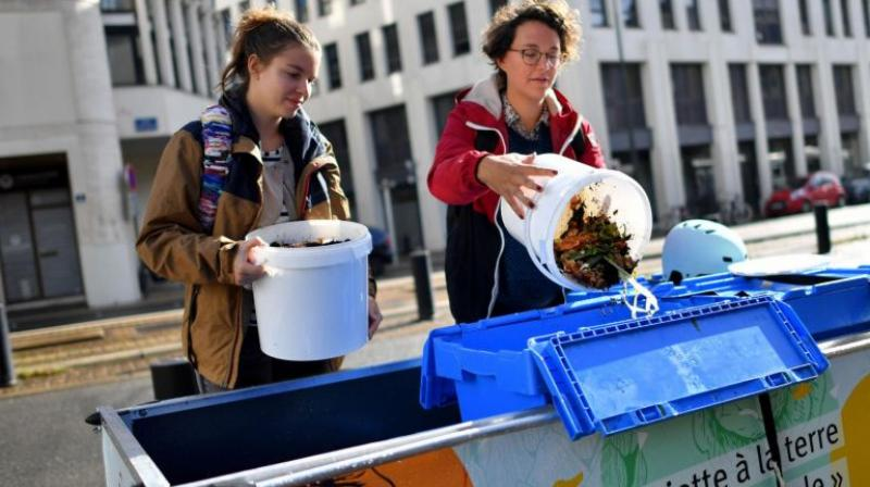 Members of La Tricyclerie association collect organic wastes from restaurants and companies to supply a compost in Nantes, western France, on Sept 11, 2017. (Photo: AFP)