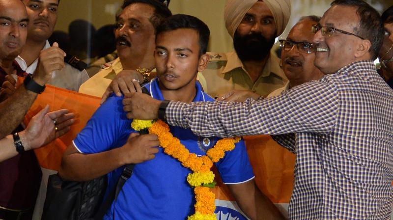 The Indian team, led by captain Prithvi Shaw, were received at the airport by senior officials of the Mumbai Cricket Association (MCA). (Photo: AFP)