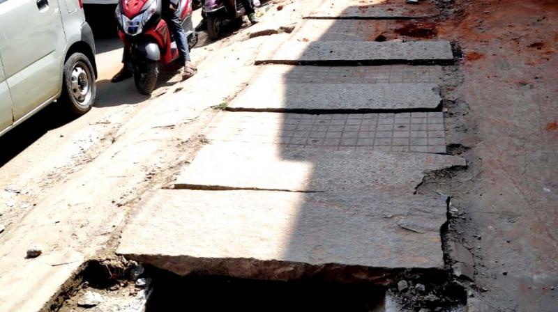 The poor condition of a footpath on NH 209 with a missing drain cover that poses life threat to pedestrians. (Photo: DC)