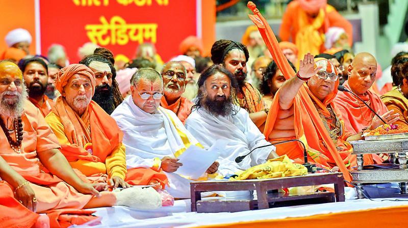 Spiritual guru Sri Sri Ravi Shankar, Akhil Bhartiya Sant Samiti chief Jagadguru Hansdevacharya and others attend the Dharmadesh, a two-day meeting of Hindu seers, in New Delhi, on Sunday. (Photo: AP)