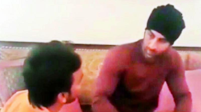 A video of the actor has gone viral where a fan greets the actor by touching his feet.