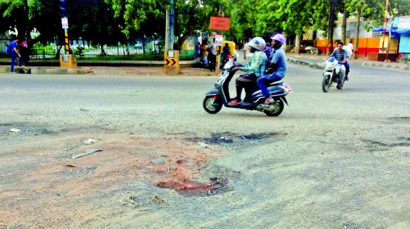 Potholes near NGV complex on 80 Feet Road in Koramangala (Photo: DC)