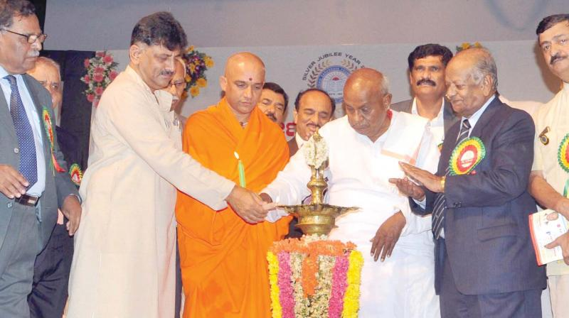 Energy Minister D.K. Shivakumar, Sri Nirmalanandanatha Swami of Adichunchanagiri Mutt and Janata Dal (Secular) supremo H.D. Deve Gowda at the silver jubilee celebrations of Krushik Sarvodaya Foundation in Bengaluru on Saturday 	(Photo:KPN )